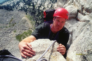 Half way up the 5.8 climbing route Open Book on the face of Lone Peak.
